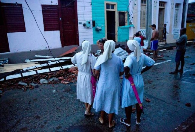 Nuns survey the damage to their home caused by Hurricane Matthew in Baracoa, Cuba. (Ramon Espinosa/AP)