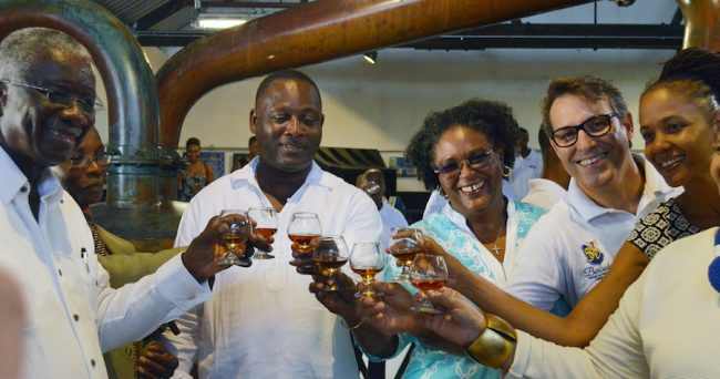 Prime Minister Freundel Stuart (left) raises a toast with Opposition Leader Mia Mottley (third from right) and other officials to Mount Gay's new limited edition rum.