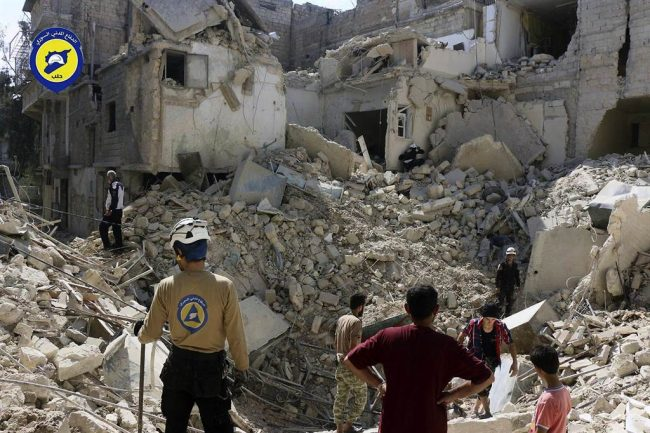 Syrian Civil Defence group known as the White Helmets, search through the rubble in rebel-held eastern Aleppo,  after a spectacular air raid hit the territory's biggest market Wednesday, killing at least 15.