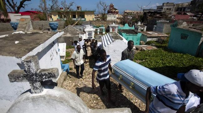 People carry the coffin of Roberto Laguerre to bury him at the cemetery in Jeremie, Haiti, Saturday, Oct. 8, 2016. Roberto, 32, died when the wall of a church next door to his home fell during Hurricane Matthew. (AP Photo/Dieu Nalio Chery)
