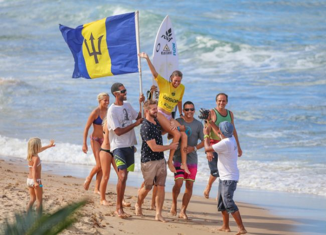 Chelsea Roett, Open Women's champion, is carried by fans after her exciting surf. (Picture by Robin Barker of Visublast)