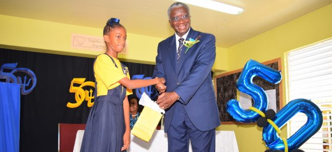 School's head girl Janae Jordan-White presented Prime Minister Stuart with a token of appreciation.