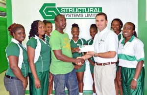 General manager of Structural Systems Andre Gibson (third right) presents the sponsorship cheque to Rodney Pilgrim. At right is club president Ingrid Folkes.