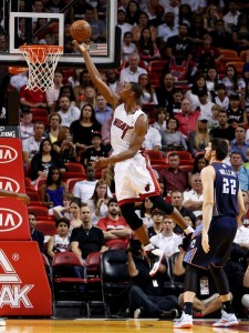 Heat's centre Chris Bosh lays up during the game against the Bobcats.