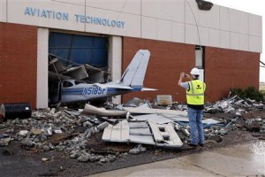 Cary Dehart photographs tornado damage at Canadian Valley Technology Center's Aviation Technology building in El Reno