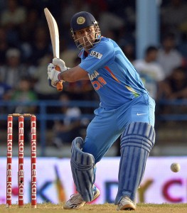 Man-of-the-Match MS Dhoni is set to launch the ball out of the ground that brought India their series victory.