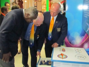 Prime Minister Freundel Stuart (left), President of the BOA, Steve Stoute (centre) and Director of the Olympic Academy, David Farmer, pay close attention to one of the exhibits at the BOA's Museum.