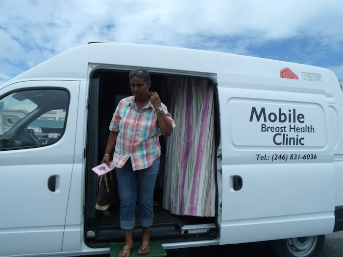 Gilda Springer steps out of the Barbados Cancer Society mobile vehicle after her breast screening.