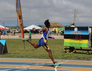 Victrix ludorum Tristan Evelyn powering over the finish line as Jamar Browne commentates.