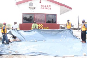 Officials of Rayside Construction Limited and E-Z Pave unveiling  an example of the colourful concrete pavement.