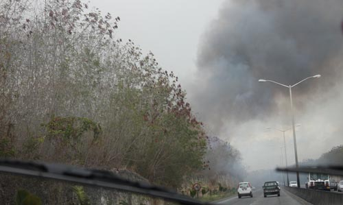 It must have been bothersome for motorists to drive through so much smoke.
