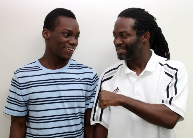 Shackeem Mascoll (left)  sharing a moment with his father and coach Sylvan Mascoll.