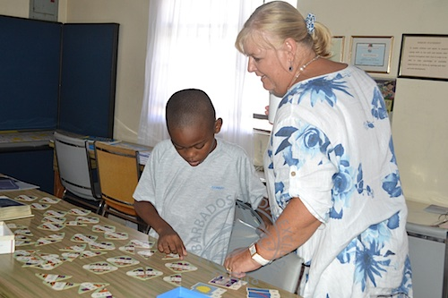 Volunteer Gloria Crookes took a little time out to interact with a 9-year-old boy, who was playing a maths game.