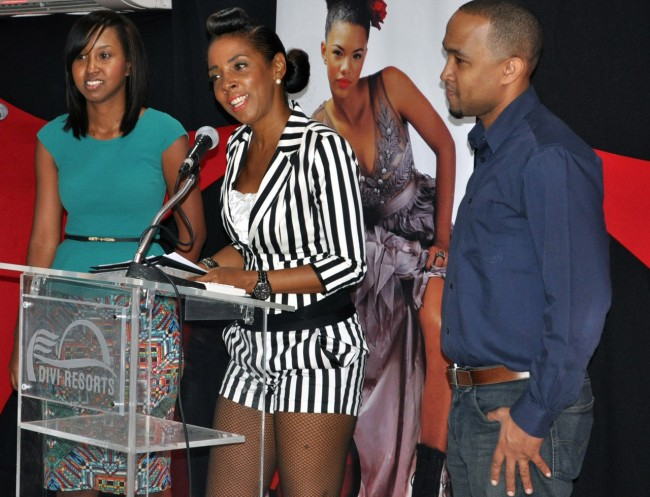 Ebonnie Rowe (centre) with longtime sponsors from Blueprint Creative.
