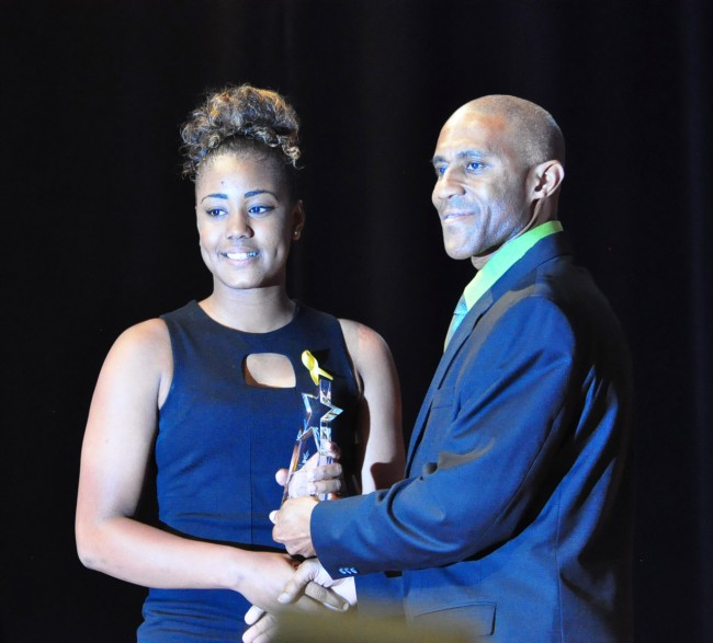 Hayley Matthews (left) is seen here accepting the Emerging Athlete Award from Roger Beckles of Barbados Light and Power.