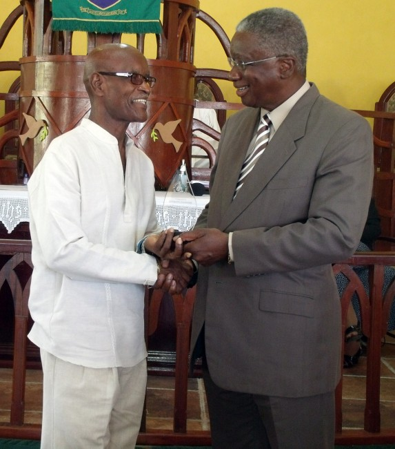 Anthony Padmore receives his award from the Prime Minister.