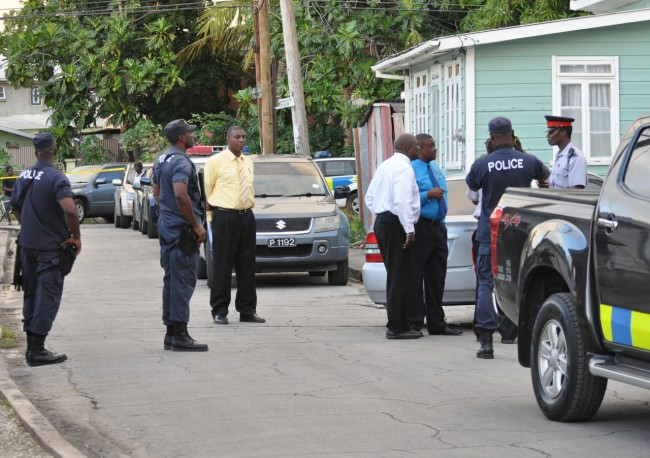 Police on the scene in Chapman Lane this afternoon. Inset, Rico Gaskin was shot in the shoulder during the chase.