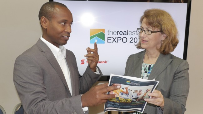 Director of The Real Estate Expo Derrick Frederick (left) speaking with Lisa Cole senior marketing                     manager of Scotiabank.