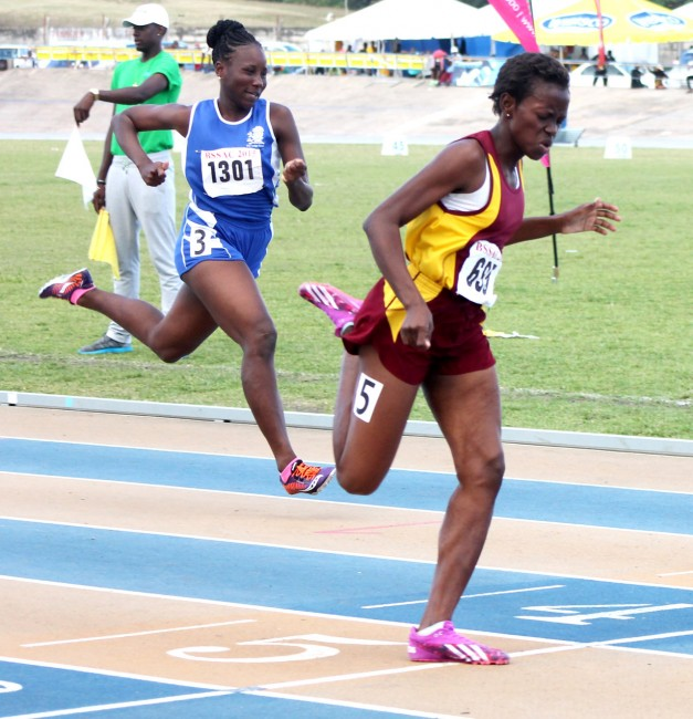 Asha Cave of Harrison College slammed the field in the under-20 boys 100m.