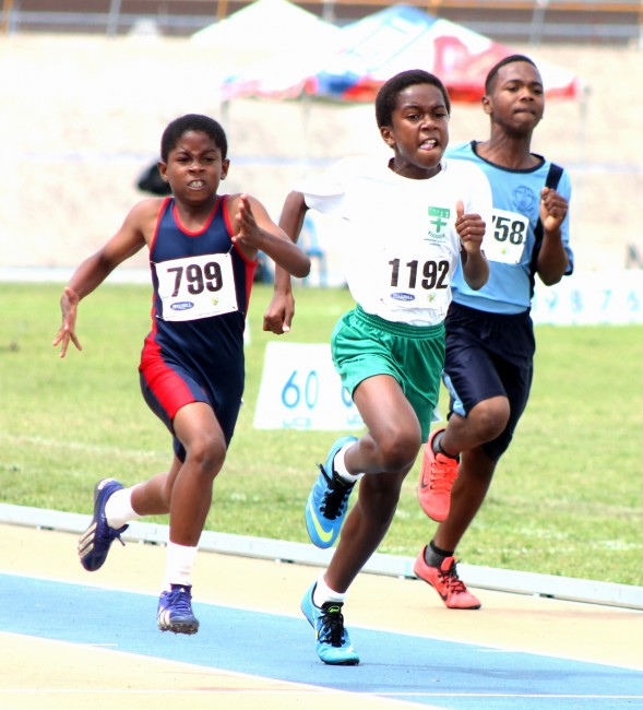 (From left) Caleb Massiah of Charles F. Broome powered his way to victory in the under-13 boys 200m ahead of Kobe Hutson of St Angela's.