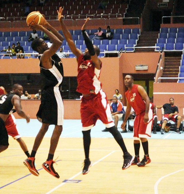 Peter Alleyne (right) contesting this jump shot by Kevin Andrews.