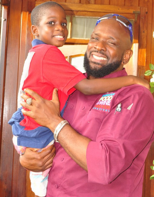 Xavier Bertrand in the arms of chef Gregory Austin.