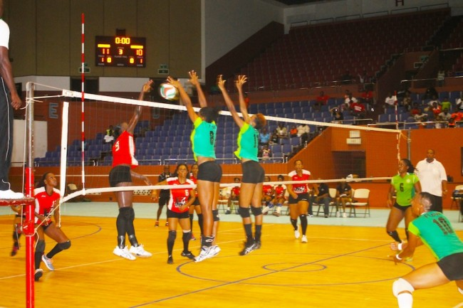 Deacons' Shonte Seale and Deanne Smith (at the nets) blocking a shot taken by Warrens captain Rhe-Ann Niles.