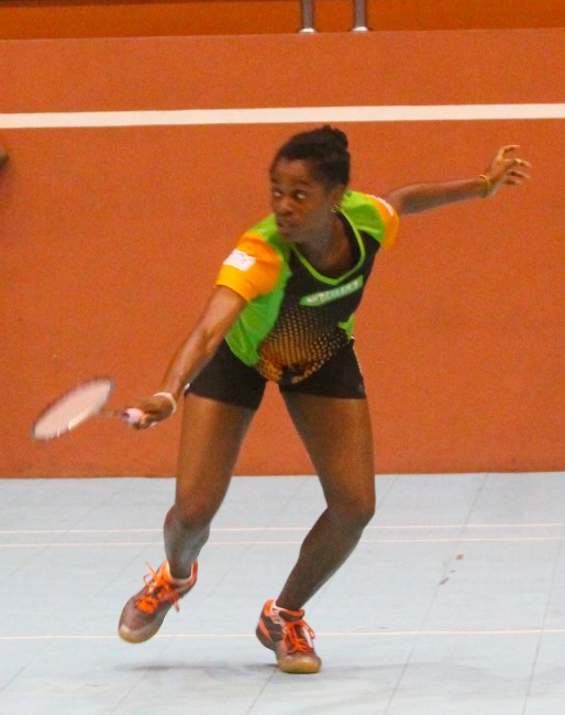 Tamisha Williams of Shuttlers A plays a backarm shot against Amanda Haywood of Juniors A.