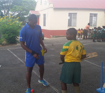 Omar Phillips taking this youngster through the paces