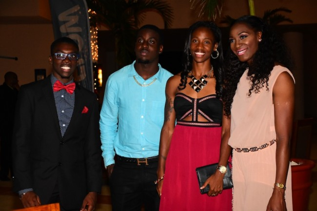 (From left) Athletes Rivaldo Leacock, Levi Cadogan, Kierre Beckles and Akela Jones at the cocktail reception last night.