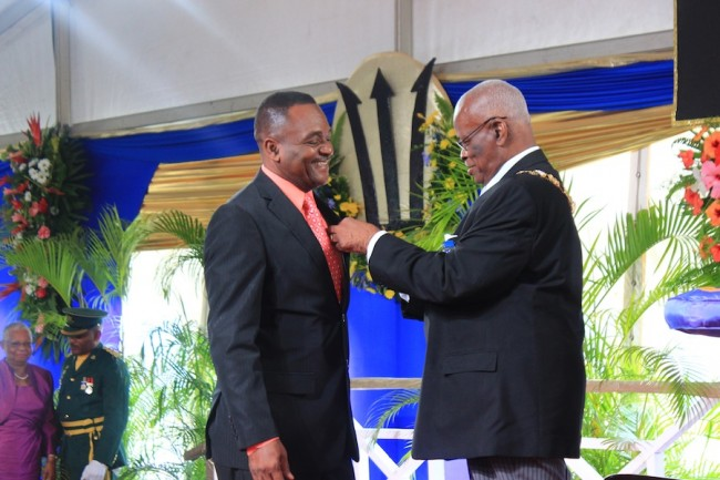 Educator Matthew Farley receiving his medal from Governor General Sir Elliott Belgrave.