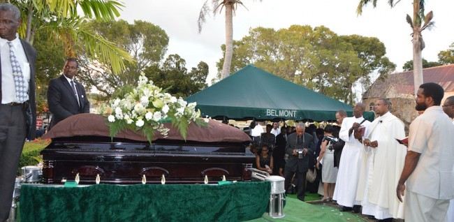 The casket bearing the body of the late Norma Holder is about to be lowered into her grave at the St George Parish Church where she served as organist.