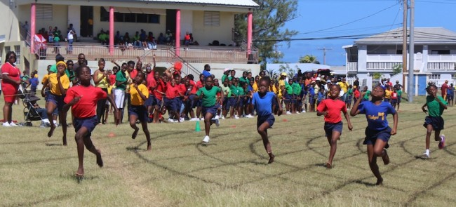 It was a tough contest in the under-11 girls' 400m among Jelissa Estwick (left), Makeda Greaves (second left) and Chinara Greenidge (centre, blue shirt) but in the end Estwick took the glory.