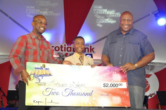 Browne Star receiving his $2,000 grand prize from Minister of Culture Stephen Lashley and Barbados TODAY's David Williams for winning the Barbados TODAY Junior Champion competition.