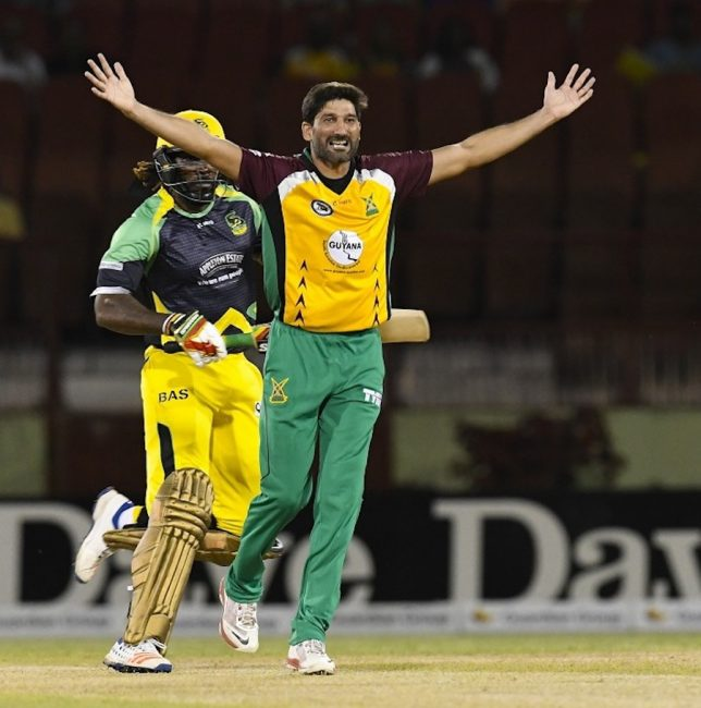 Fast bowler Sohail Tanvir gets the crucial wicket of Chris Gayle for a duck.