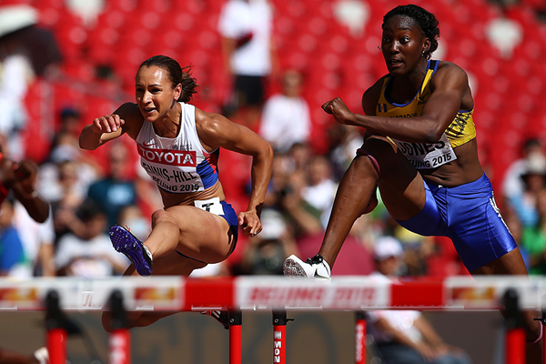 Akela Jones (right) and Jessica Ennis-Hill competing in the heptathlon 100m hurdles at the World Championships last year.