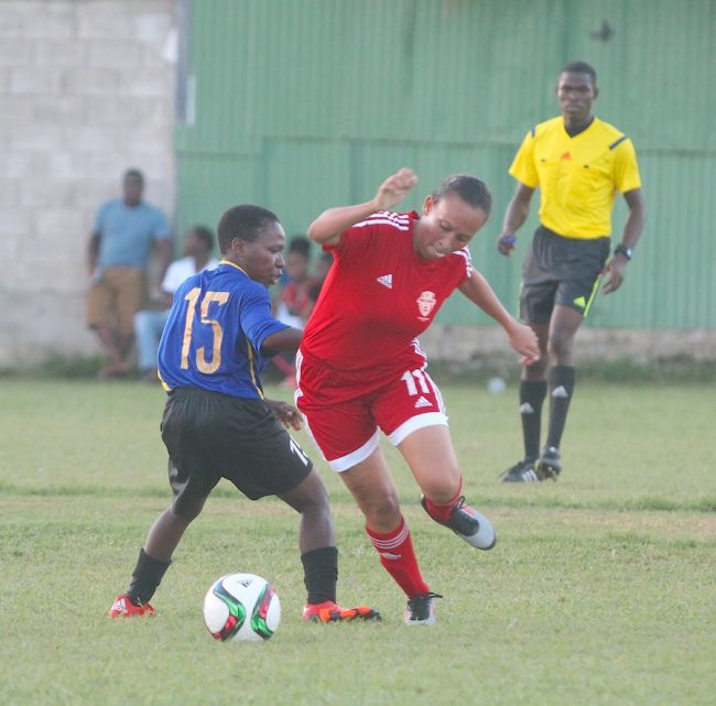 Ailsa Walcott of Kick Start is left in her tracks as Antonia Baptiste of Braddies Bar Pinelands dribbles past her under the watchful eyes of referee Kevin Bartlett. (Pictures by Morissa Lindsay)