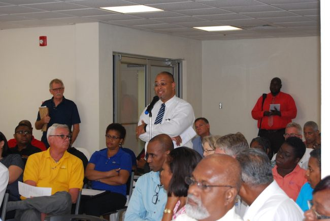 Here, the CEO of Robert's Manufacturing, Jason Sombrana, calls on Government not adopt a heavy handed approach to entities not yet in full compliance with the tax as other stakeholders, including businessman Ian Pickup (standing to his left), look on.