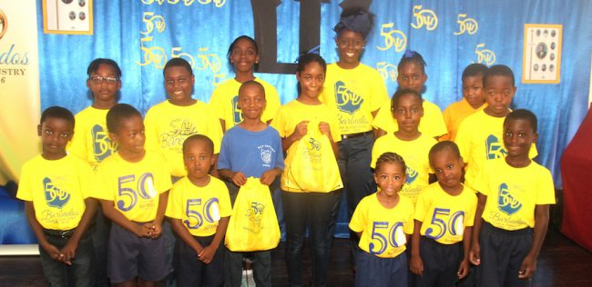 Teacher, Keisha Collymore (third from right in back row) standing among students of Bay Primary wearing their independence shirts during Friday's launch. (Pictures by Clifton Henry.)