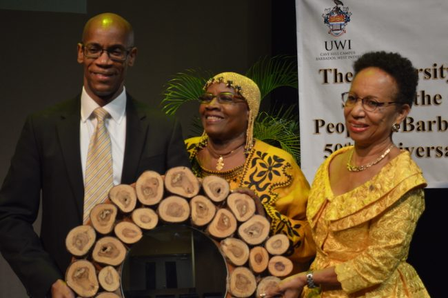 Principal of UWI Cave Hill Campus Professor Eudine Barriteau poses with Cynthia Wilson and her son Mark.