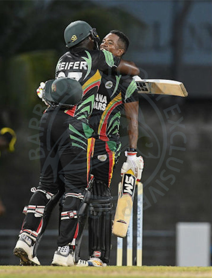 The batting of Raymon Reifer (left) and Leon Johnson saw the Jaguars to victory. Here they embrace after Johnson reached his century.