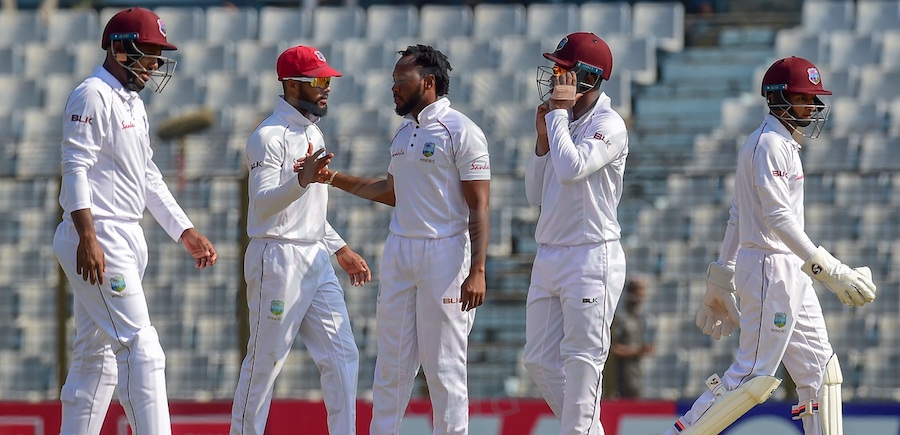 Jomel Warrican (third left), who has so far taken six wickets in the match, is congratulated by teammates after claiming another Bangladeshi wicket.