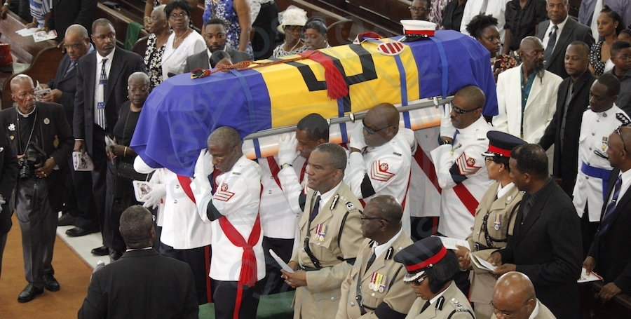 Station Sergeant Juan Icilma Walrond's casket being carried by members of the Royal Barbados Police Force during the official service.