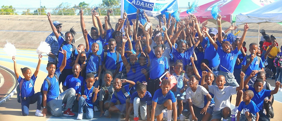 Adam House celebrate as champions of St Giles Primary inter-House sports for the fourth consecutive year.