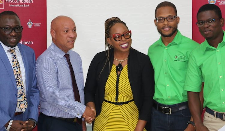 From left, Minister of Small Business, Entrepreneurship and Commerce Dwight Sutherland; Director of Platinum and Business Banking CIBC Richard Phillips and joint first prize winners Franz Harewood-Hamblin of Grow Smart Youth Farm and Kemar Codrington and Mikhail Eversley of Oasis Laboratory.