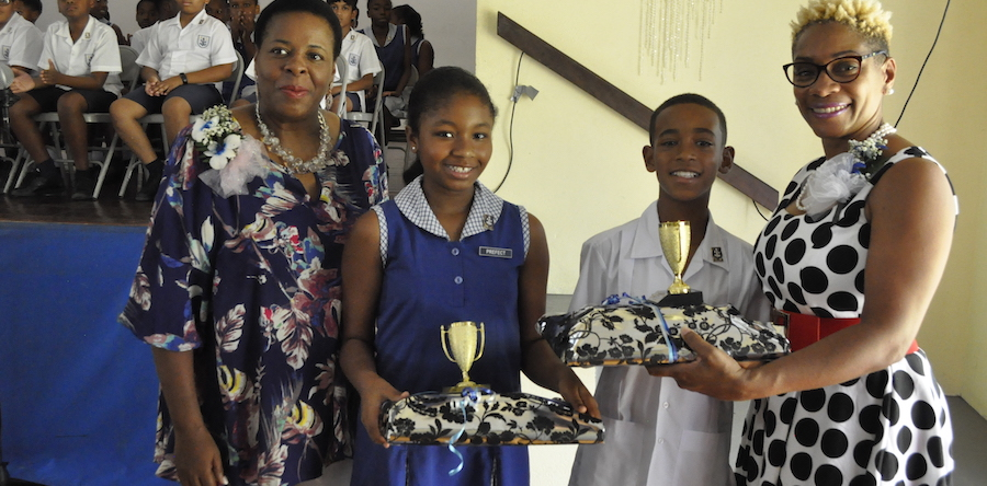 From left, Principal of St Gabriel's School Angela Blackett, Top students Adriel Bayrd and Joshua Connell being presented their prizes by featured speaker Carol Toppin.