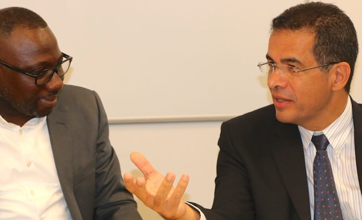 Rubis' chief executive officer Mauricio Nicholls (right) and Minister of Commerce Dwight Sutherland.
