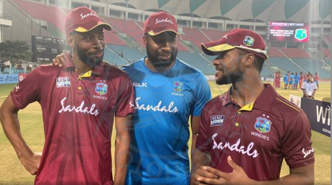 Captain Kieron Pollard (center) posing with the star performers of the ODI series Shai Hope (right) and Roston Chase.